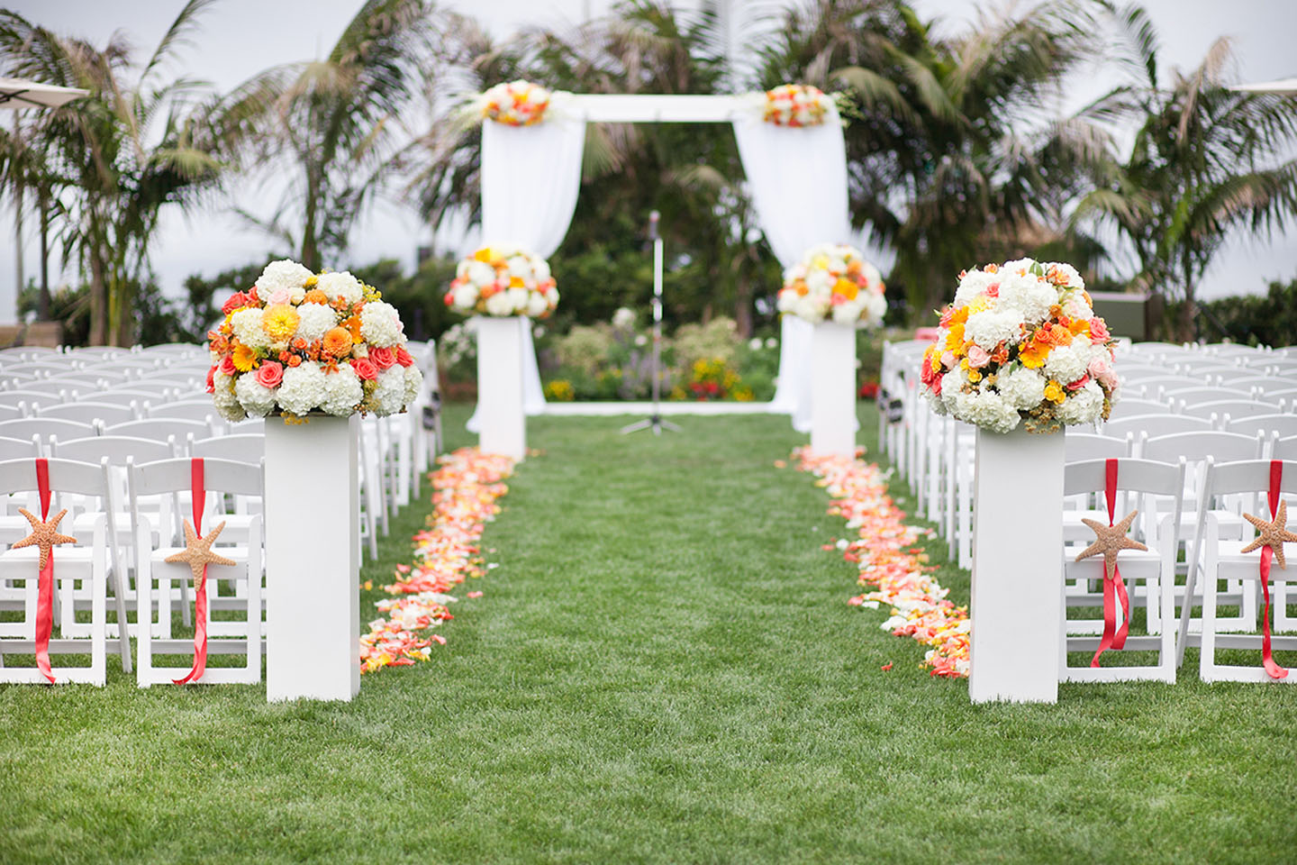Flowers line the aisle for a wedding in Carlsbad