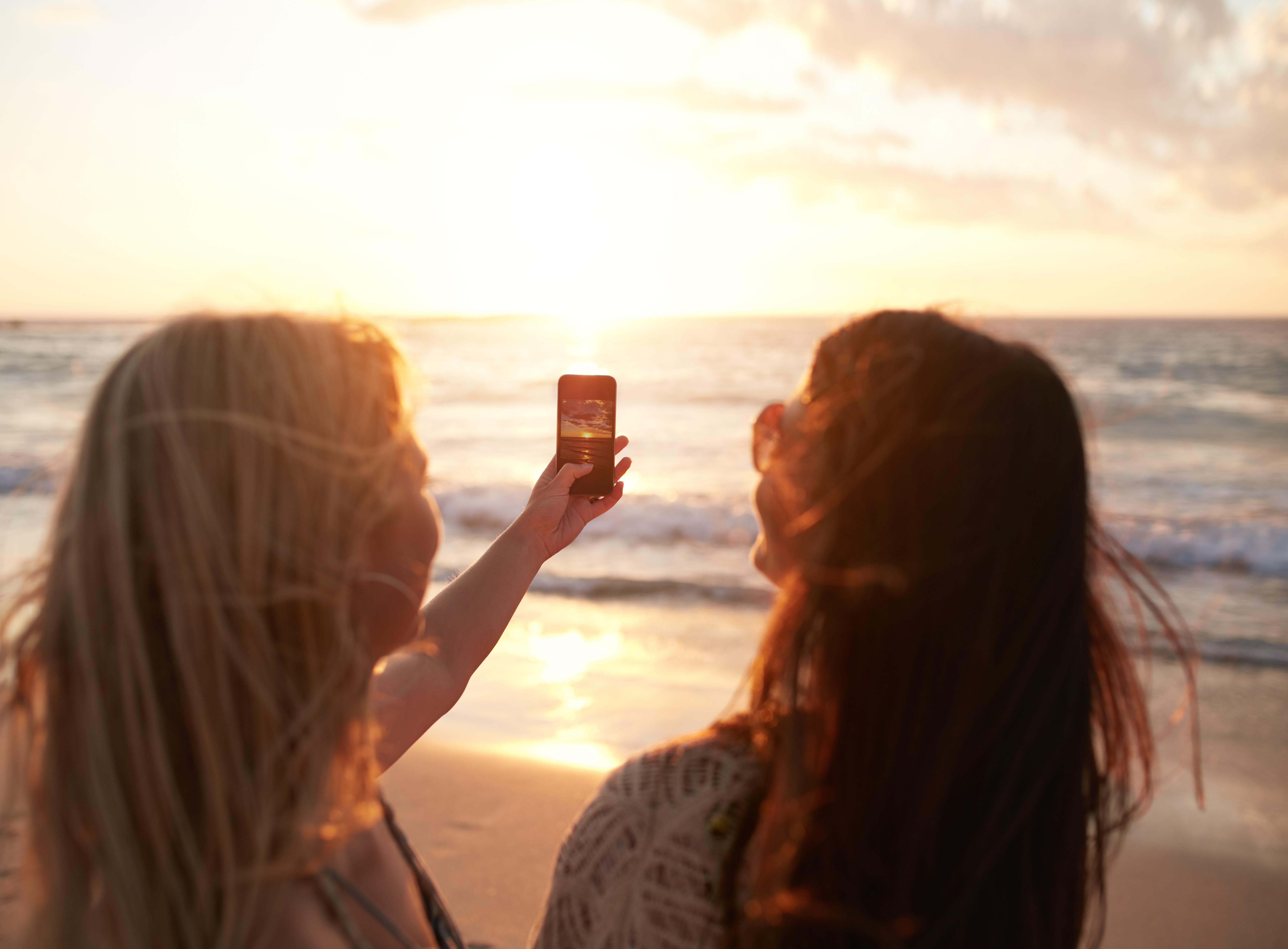 two women taking a photo